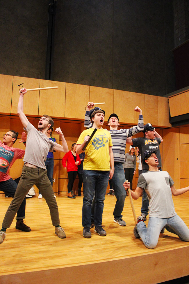Students sing and wave props while rehearsing in Rieth Recital Hall