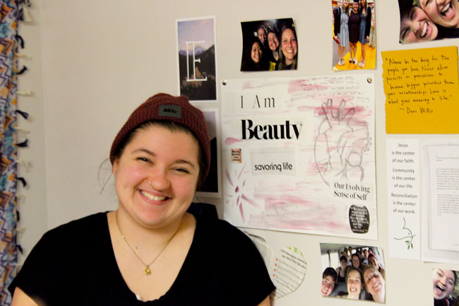 Emily Kauffman with supportive wall collage