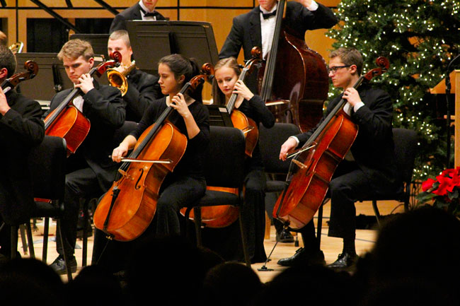 Photo of the cello section of the Goshen Symphony Orchestra performing during a concert in Sauder Hall
