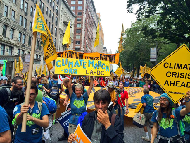 people participate in climate march