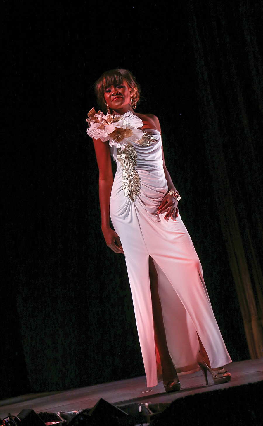 A model wears one of Eugene Stutzman's dresses on the runway