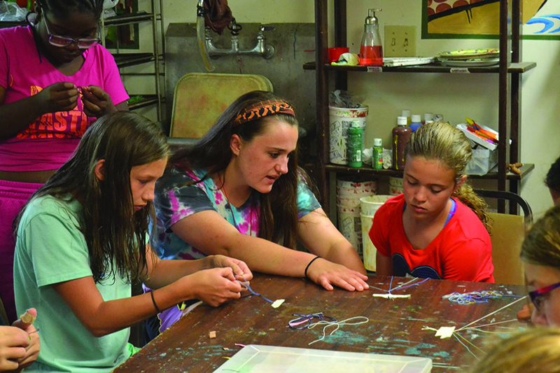 Rae Ann Miller works with campers at Friedenswald
