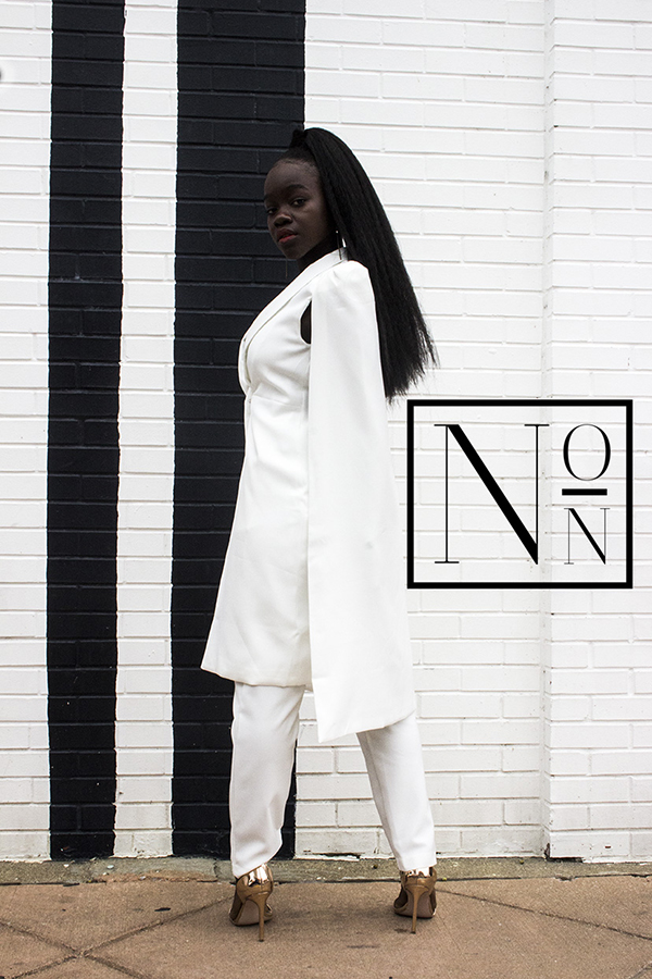 """Photo of Achieng Agutu with the logo for her new site, """"No Ordinary Noire"""" or """"NON"""""""