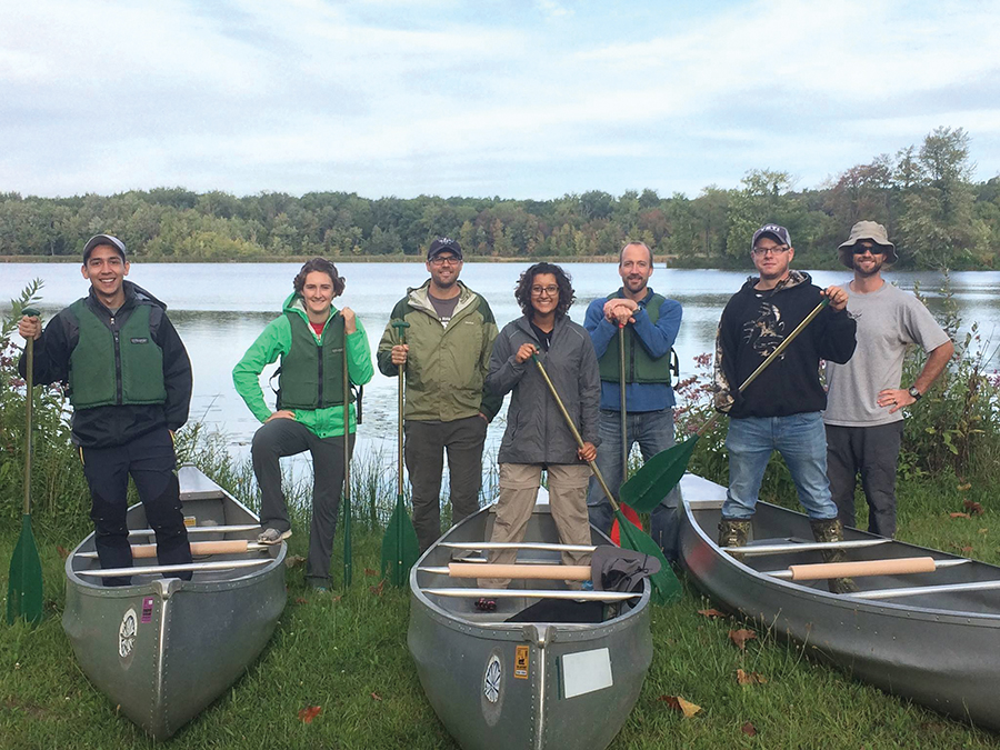 Sustainability leaders with canoes