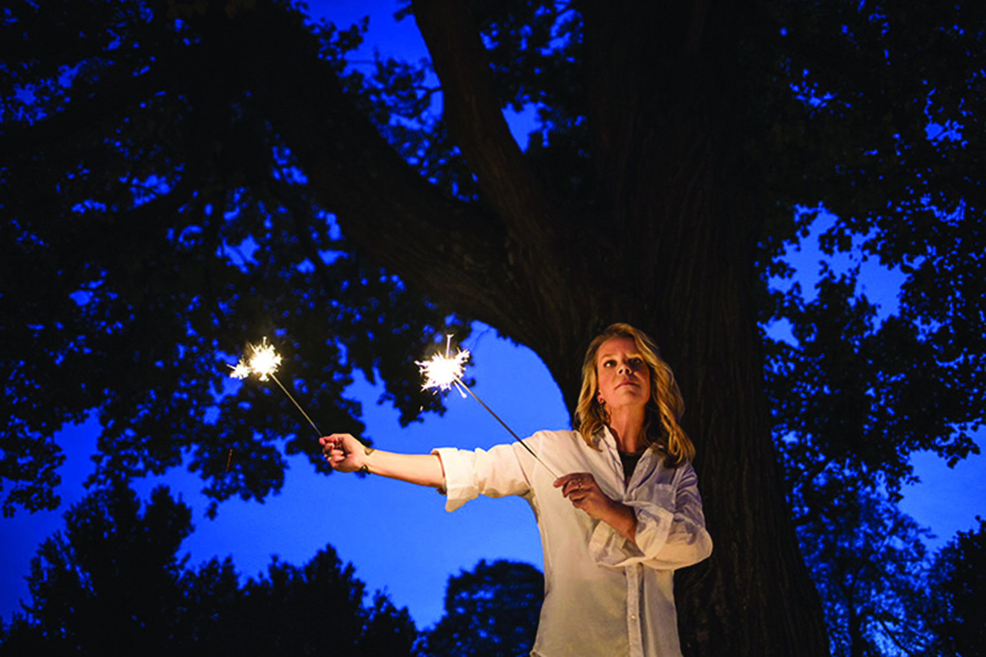 Mary Chapin Carpenter holds sparklers for a night photo