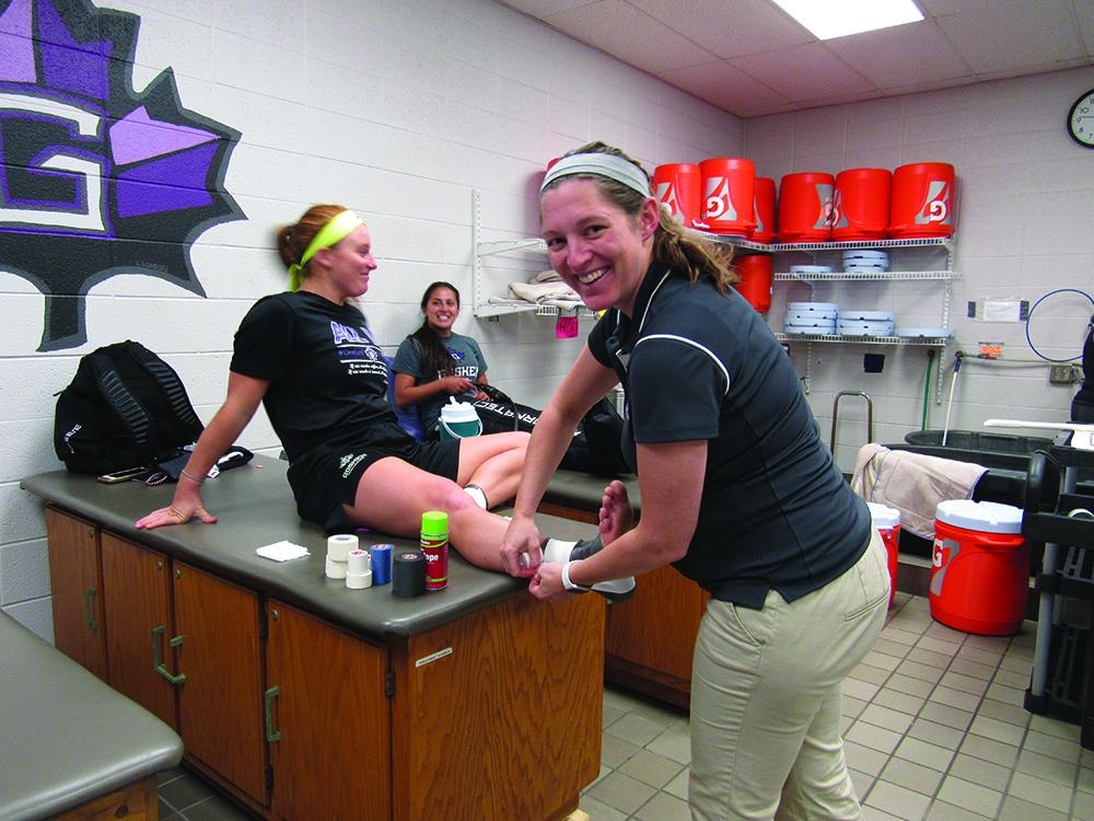 Erica Albertin treats an athlete