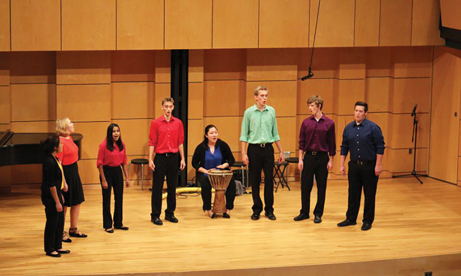 Members of the Parables ensemble sing and play the drum in Rieth Recital Hall