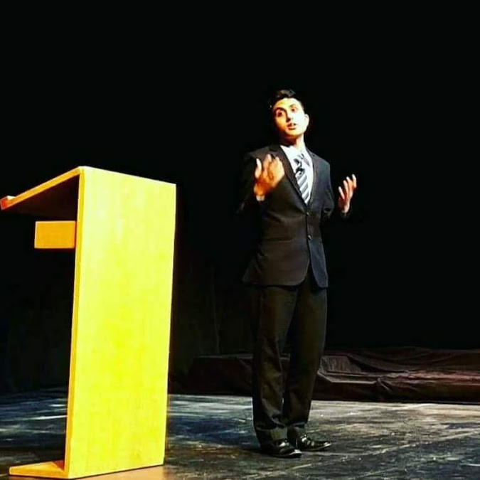 Hitesh Sharma delivers a speech in Umble Center