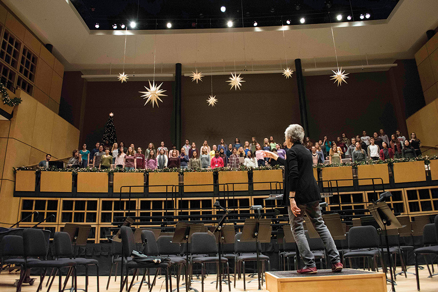 Debra Detweiler conducts the Goshen choirs during a rehearsal for Festival of Carols