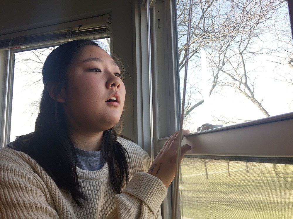Rebecca Choi looks out her window
