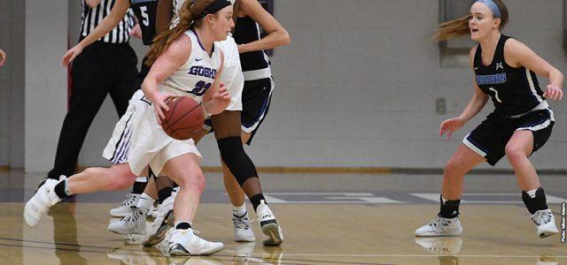 Women's Basketball plays Marian tough in final game