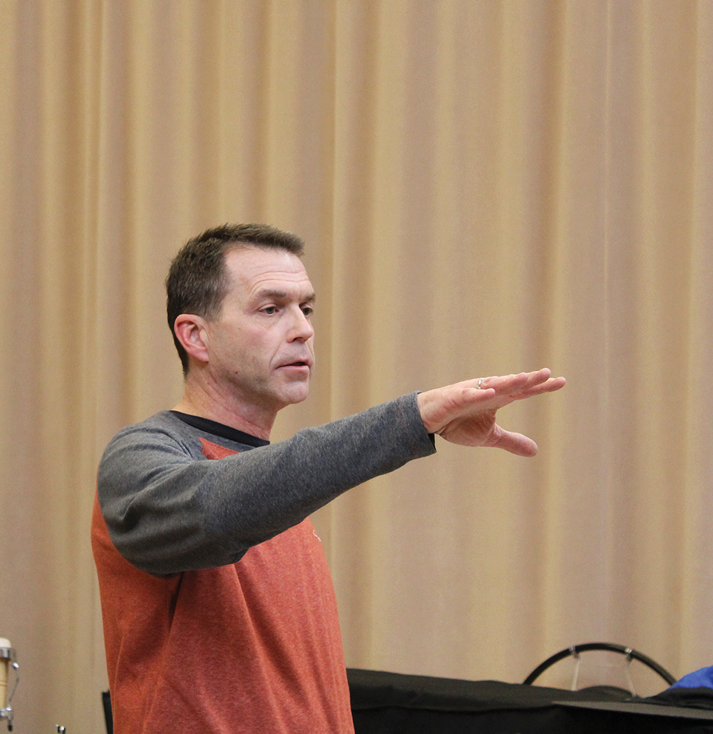 Greg Smucker conducts during a Lavender Jazz rehearsal