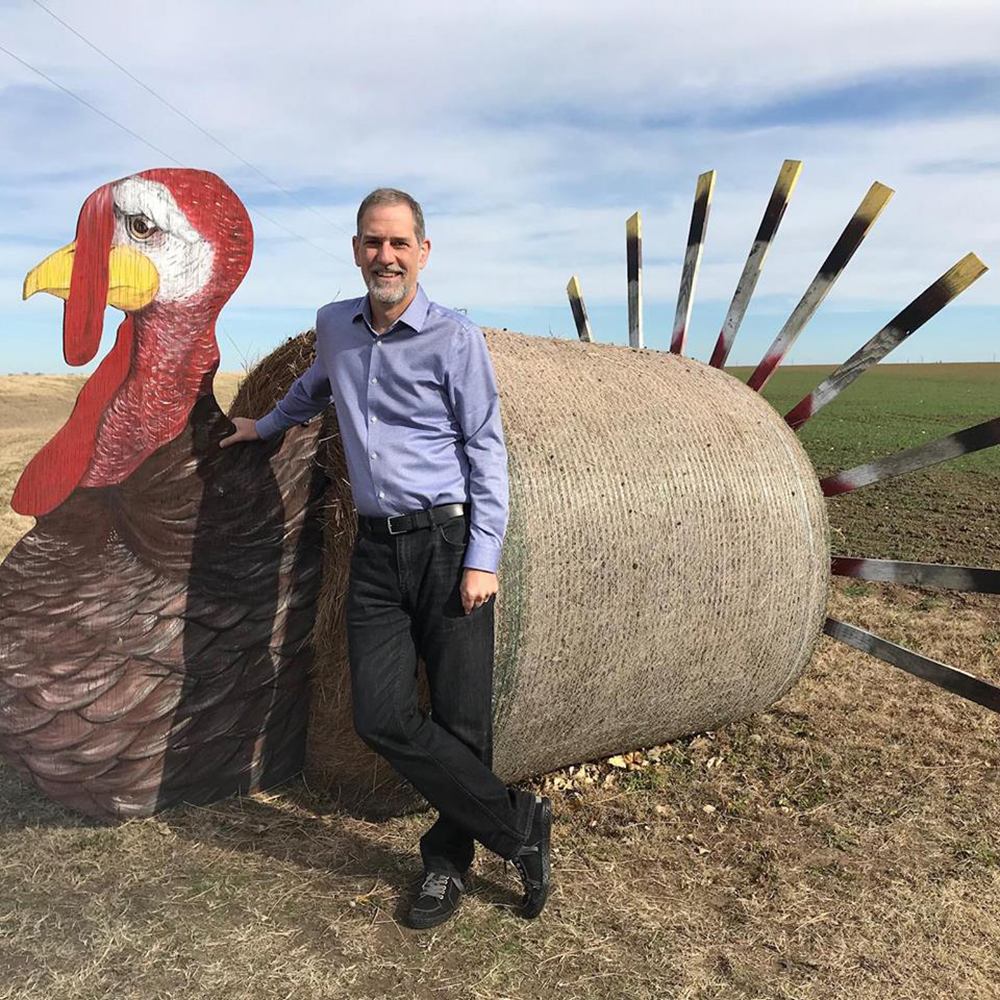 Phil Mason with a giant turkey sculpture