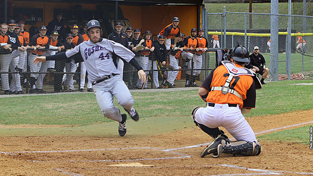 Player slides into home plate