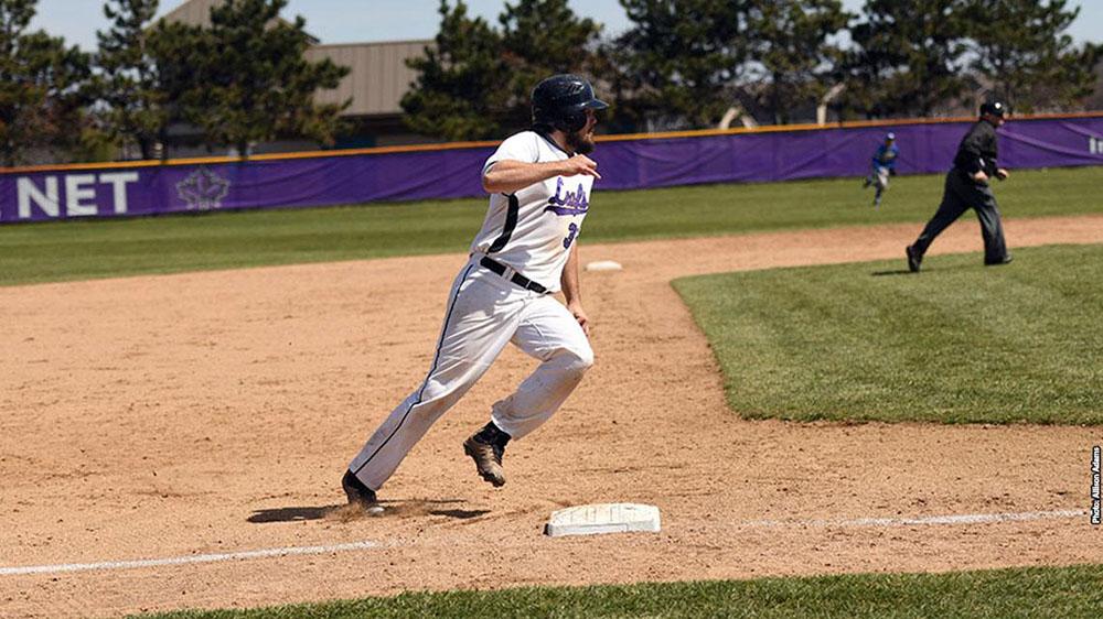 Hartig rounds the bases during baseball game