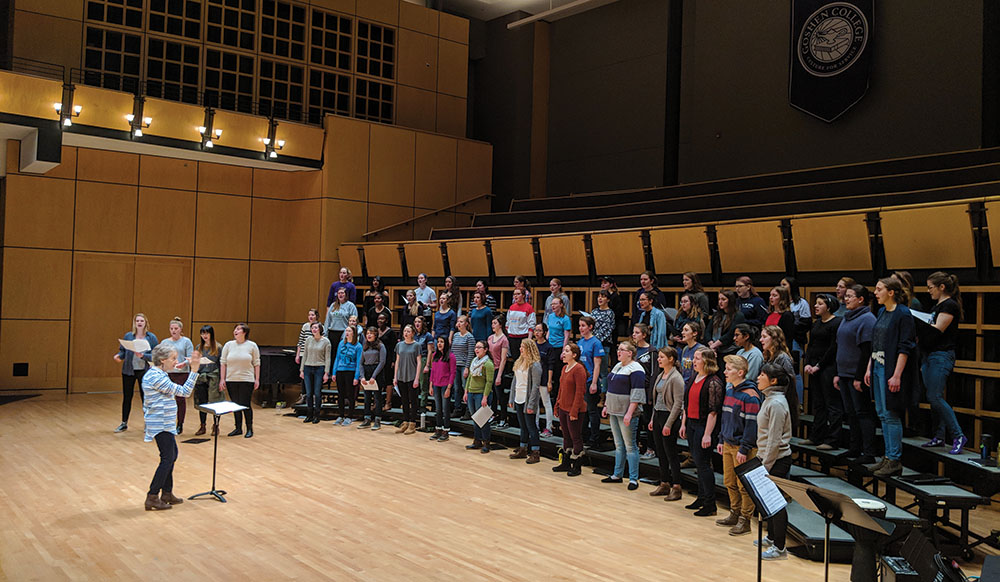 Debra Detweiler conducts a rehearsal for Earthtones in Sauder Concert Hall