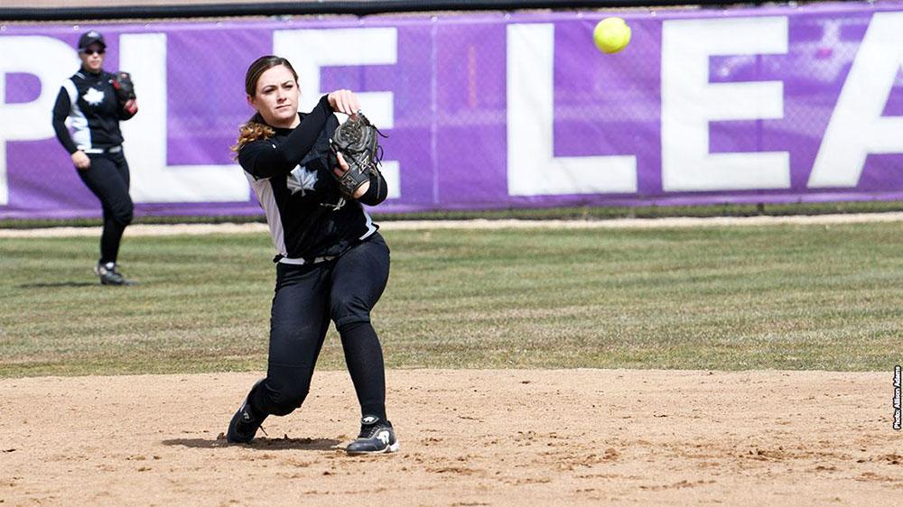 Boyer throws the softball