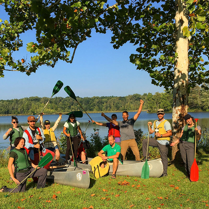 Students pose by boats during Sustainability Leadership Semester