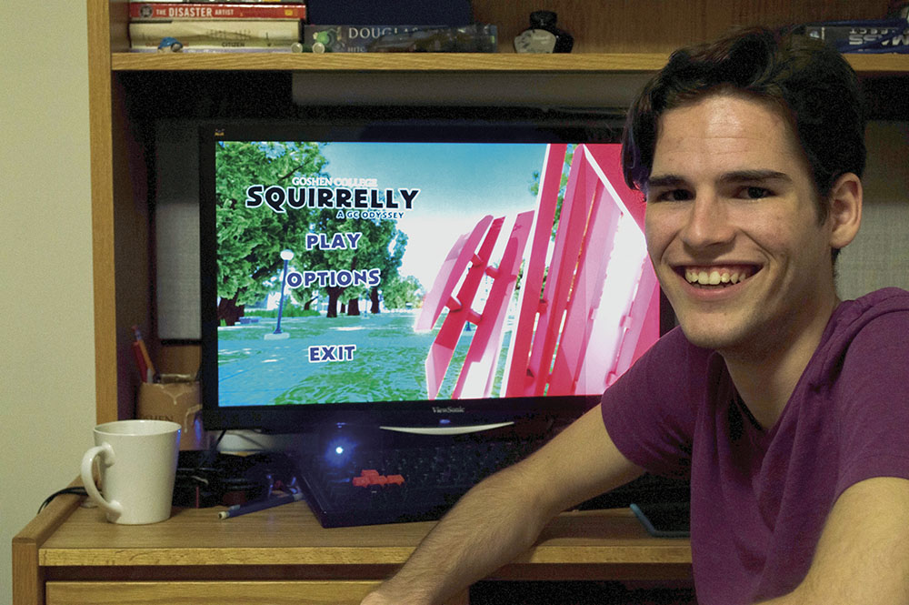 Bryce Yoder with his video game on screen