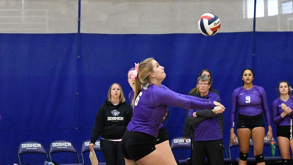 Volleyball player bumps ball up