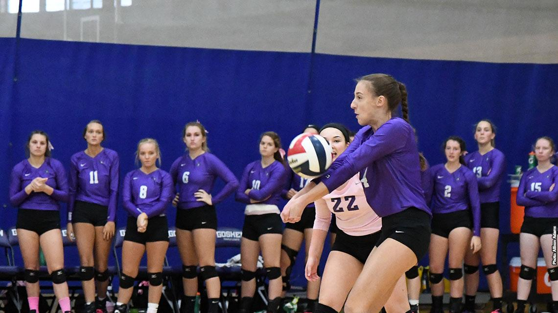Volleyball player bumps the ball