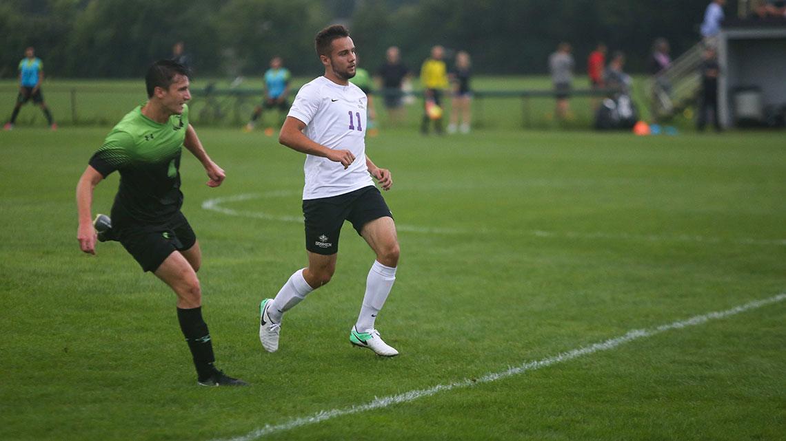 Soccer player running down field