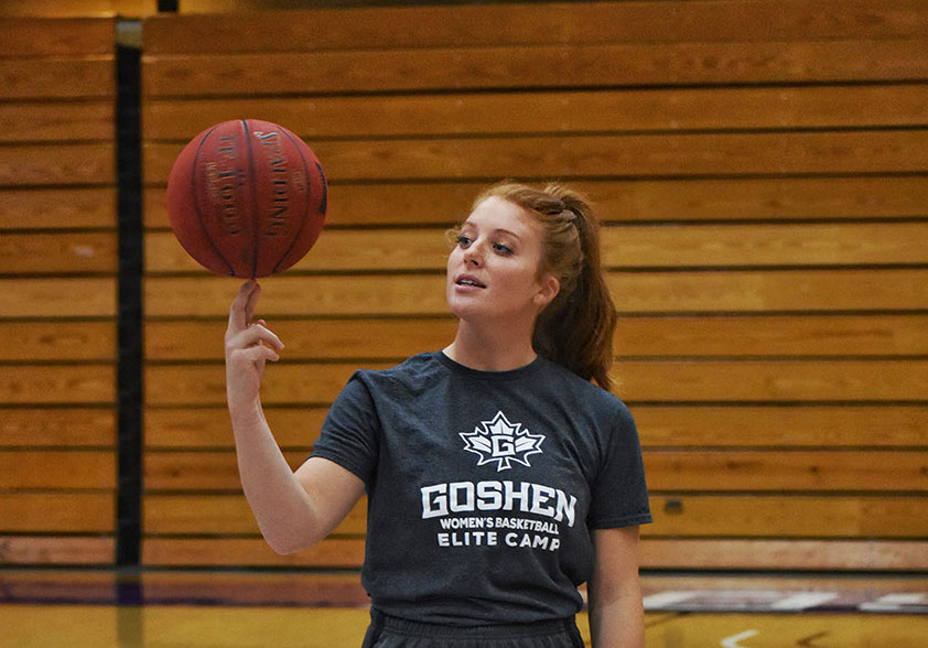 Caitlyn O'Neal spins a basketball on her finger