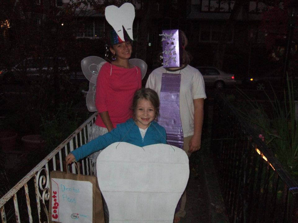 2010 Halloween photo of Dillon Hershey wearing a toothbrush costume with her friend dressed as the tooth fairy and her sister as a tooth