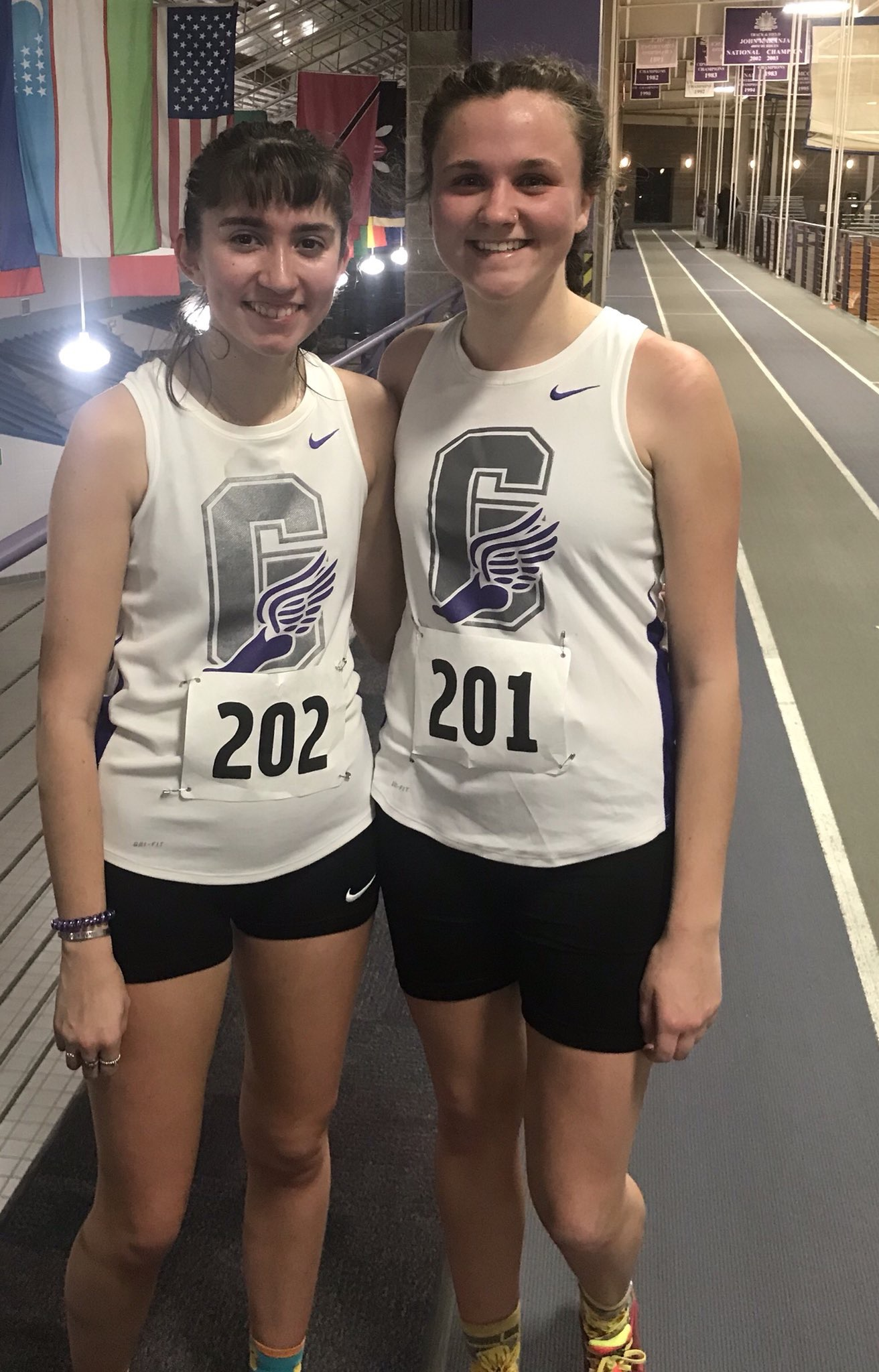Hayley Bickford and Siana Emery pose for a picture on the RFC indoor track