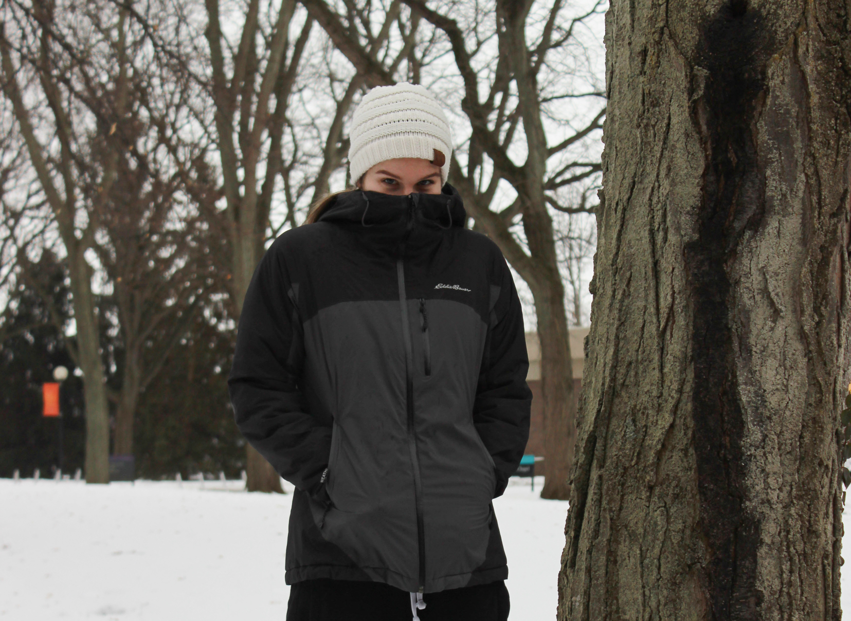 Olivia Clemens wears warm winter clothing in the snow on campus