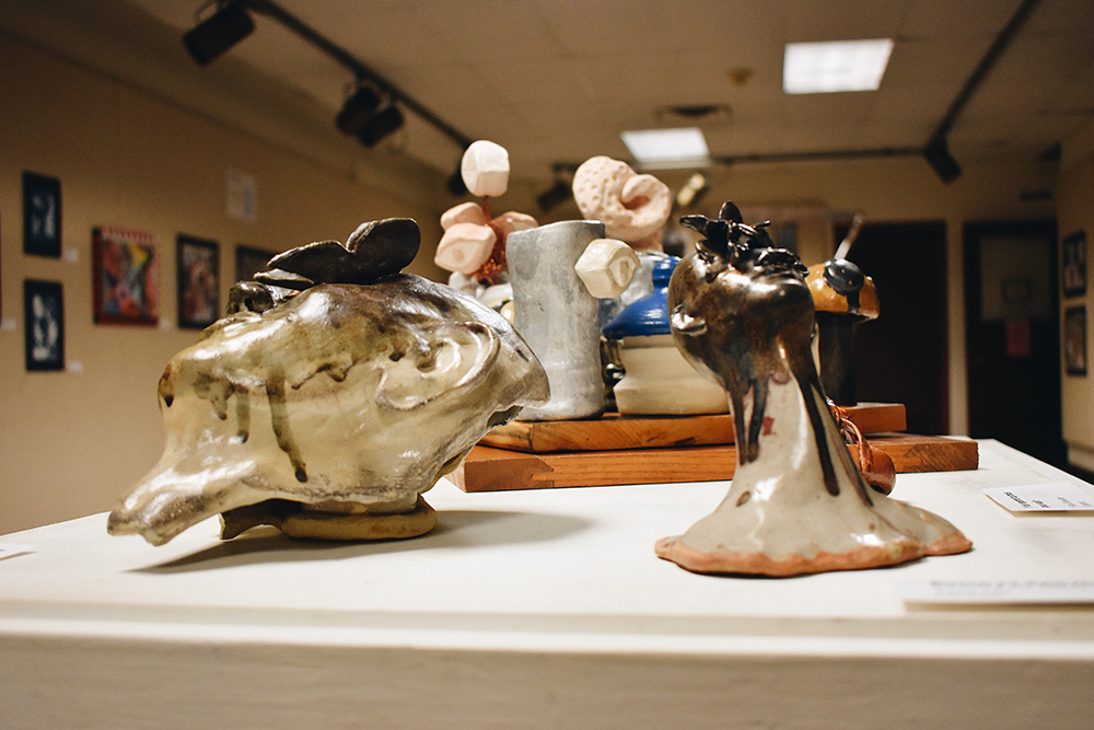 """A selection of ceramic pieces from the """"Society and the Other"""" art display in the Good Library Gallery"""