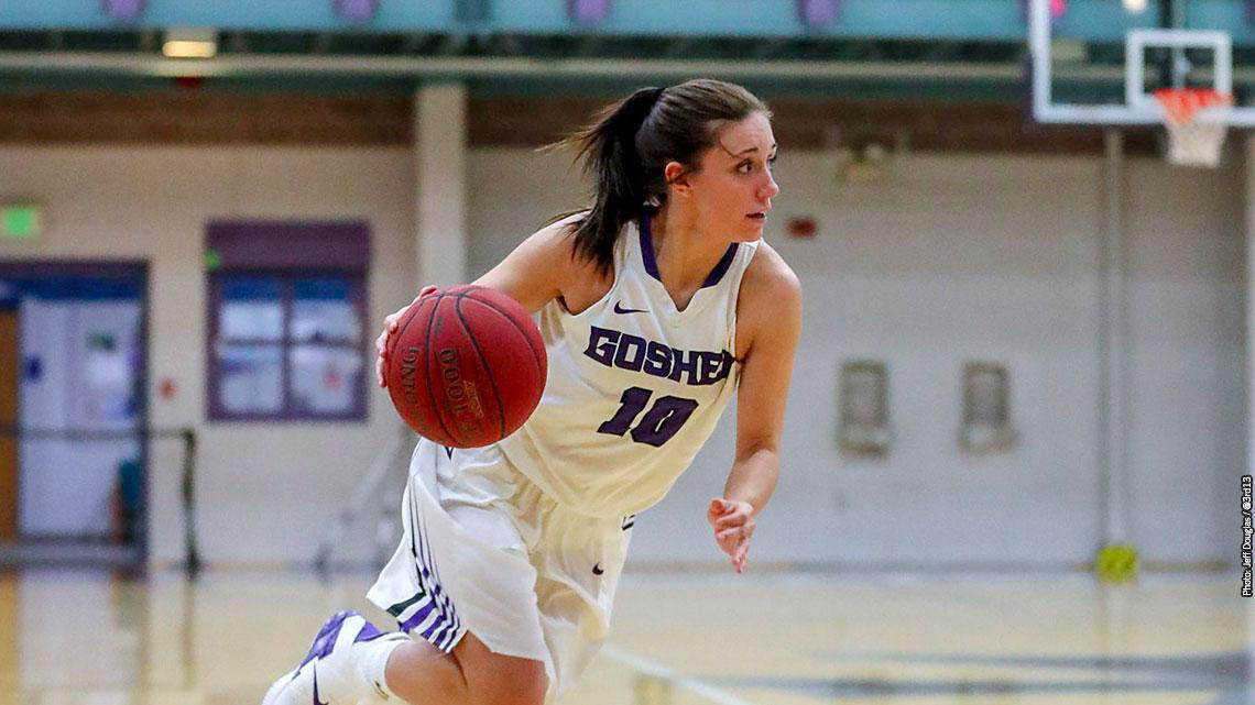 A player on the Goshen women's basketball team dribbles the ball