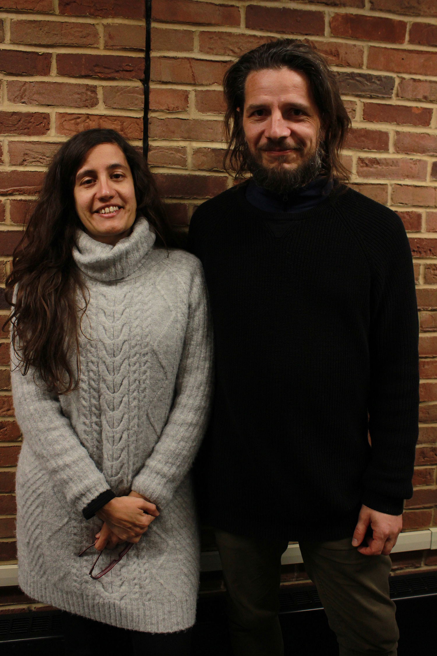 Agustina Altman and Alejandro López pose in library