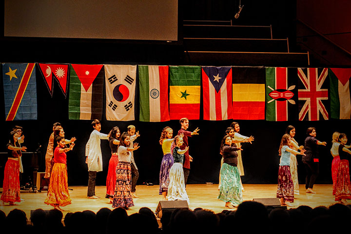 Students dance in Sauder Concert Hall for International Coffeehouse