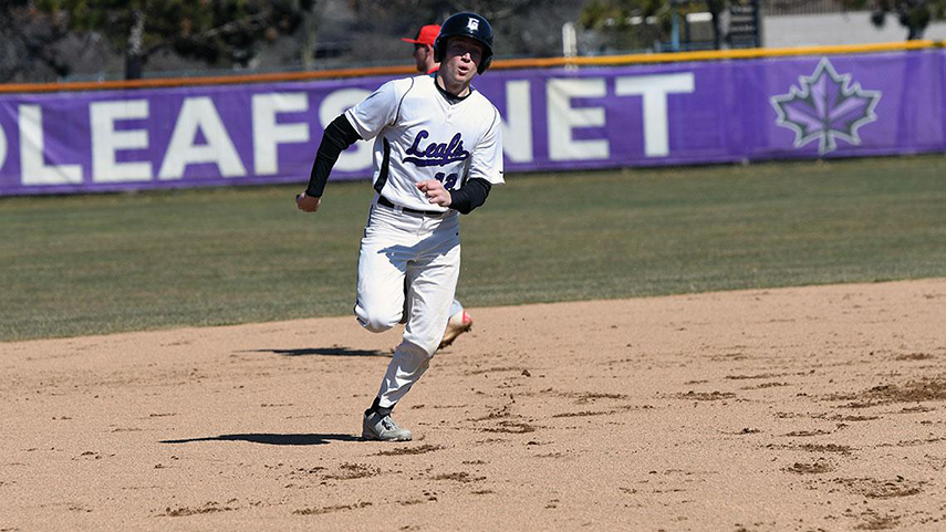 A player on the Goshen baseball team sprints to reach a base during a game