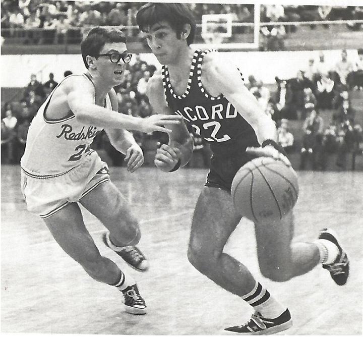 Paul Keim and Joe Liechty play basketball against each other