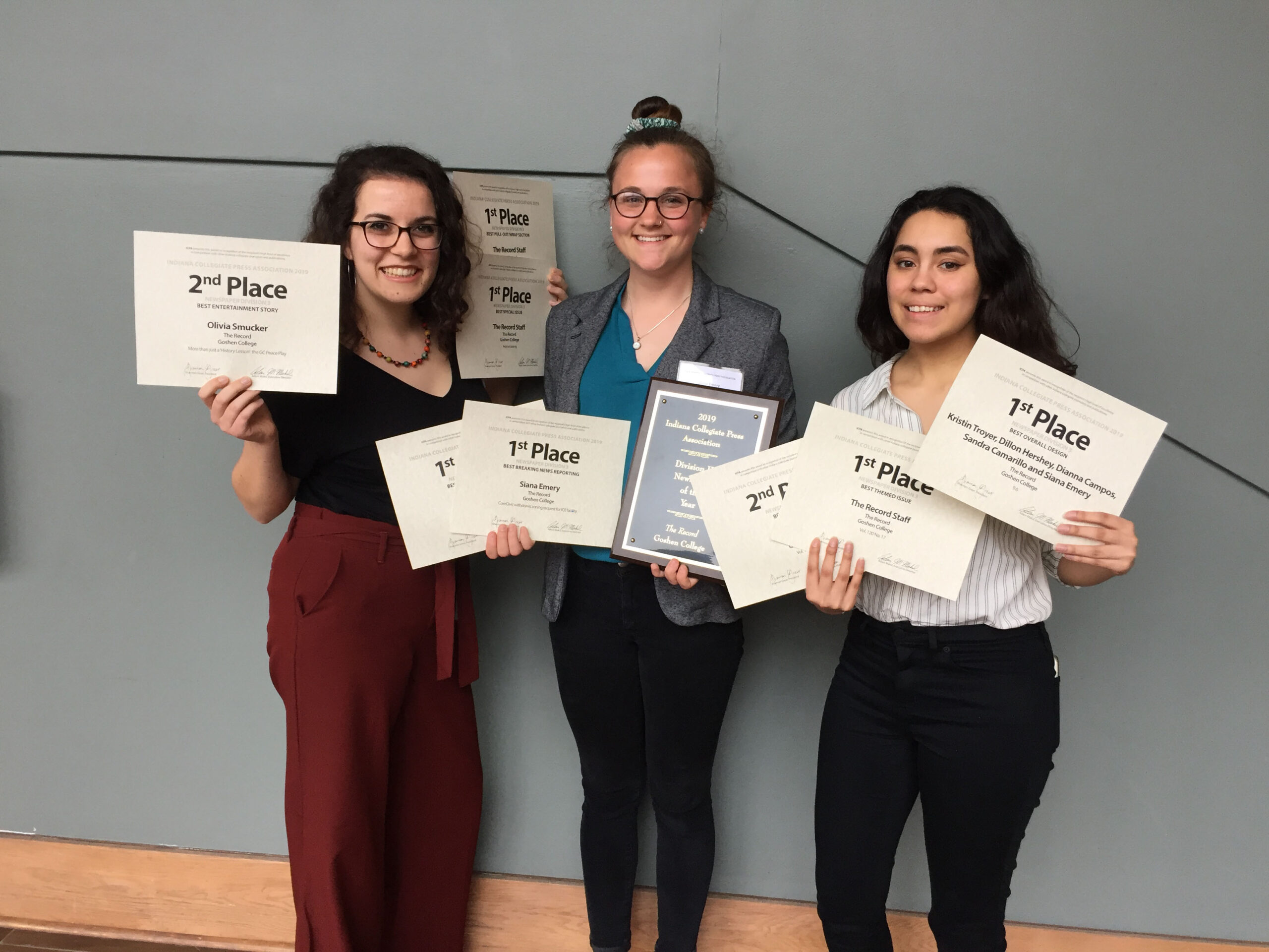 students pose with their ICPA awards