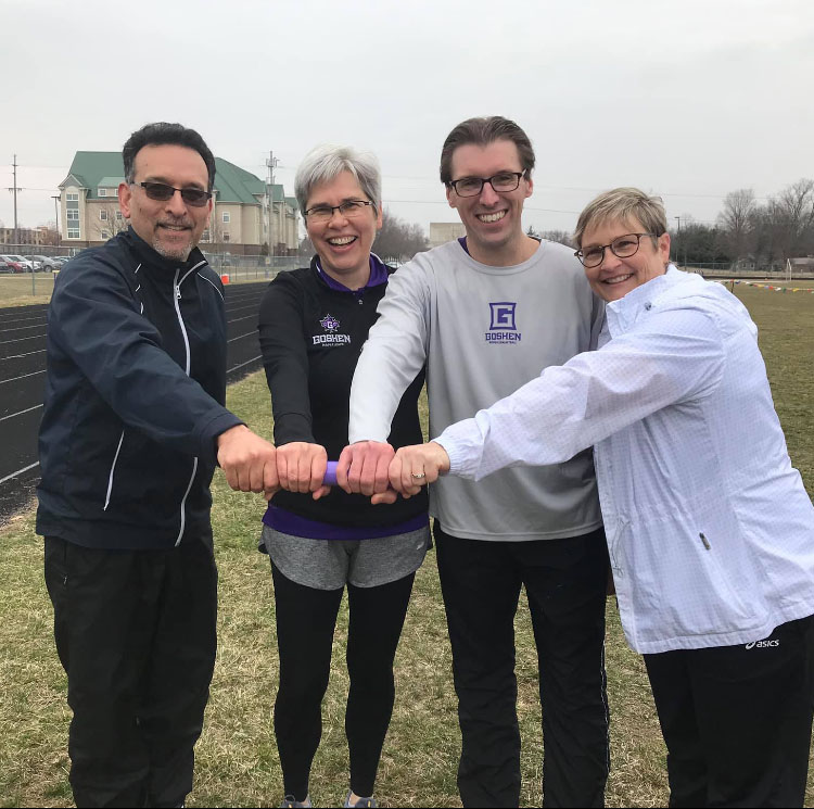 President Rebecca Stoltzfus and members of her Cabinet hold a baton and smile for the camera