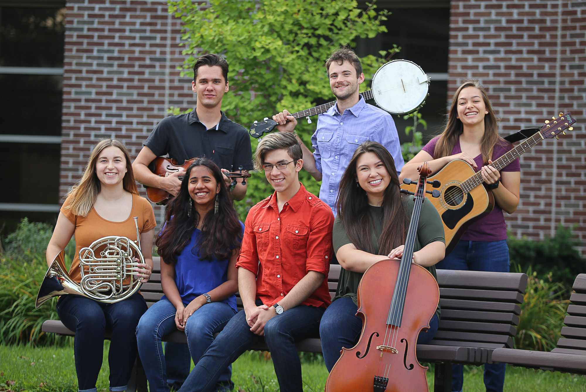 Members of the Parables ensemble pose for a picture with their instruments