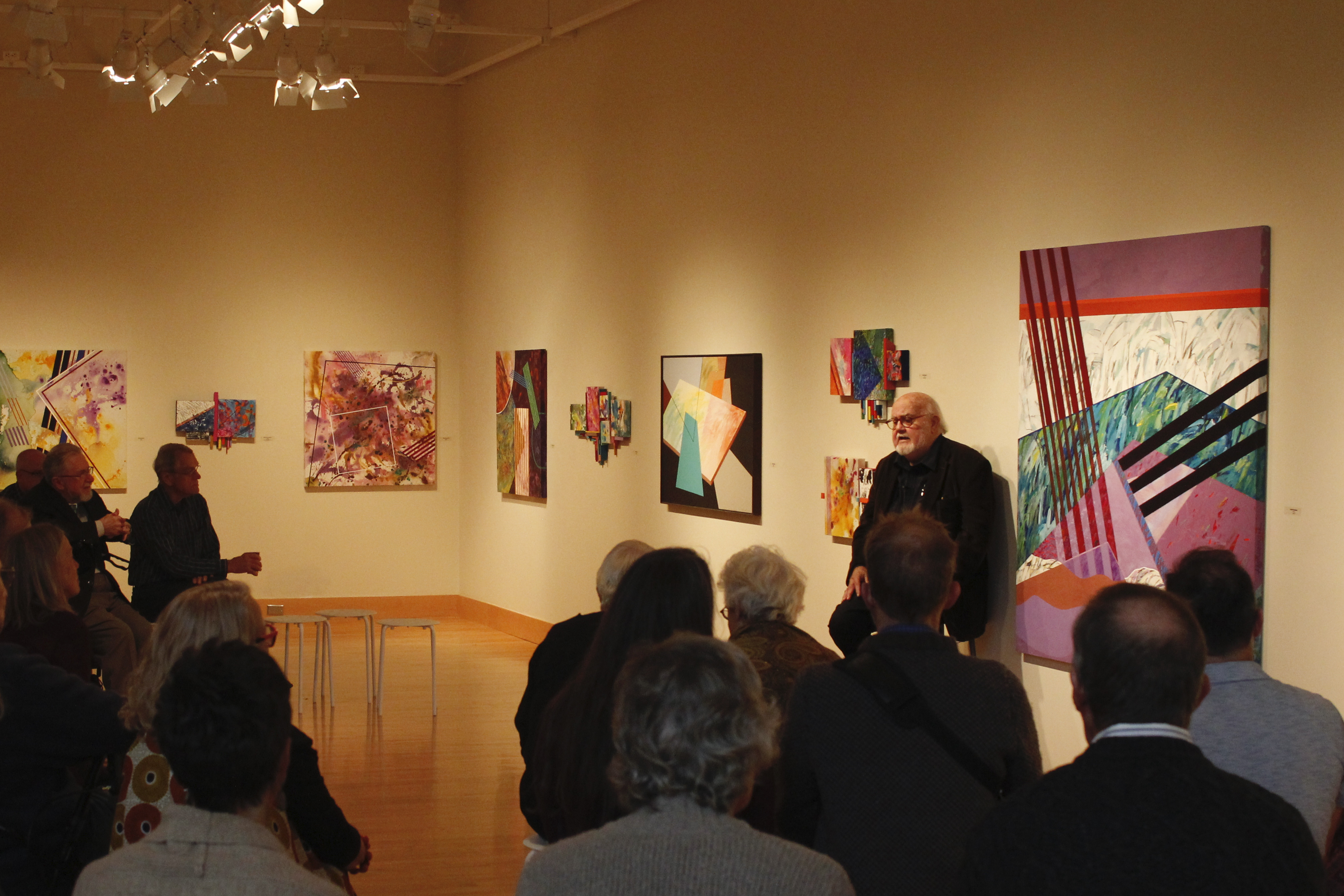 Abner Hershberger presents his artwork to an audience in the Hershberger Art Gallery