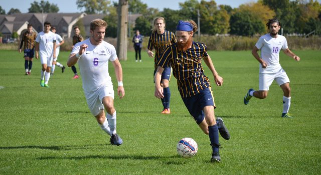 Women's soccer fall to Marian while men prevail