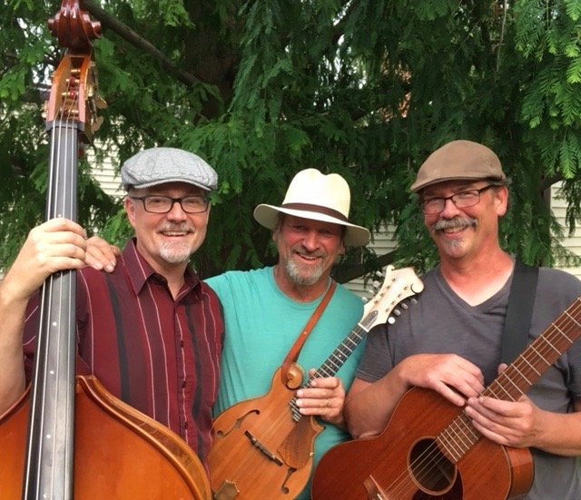Duane Gundy with his mandolin, Jim Shenk with his guitar and Randy Horst with his bass