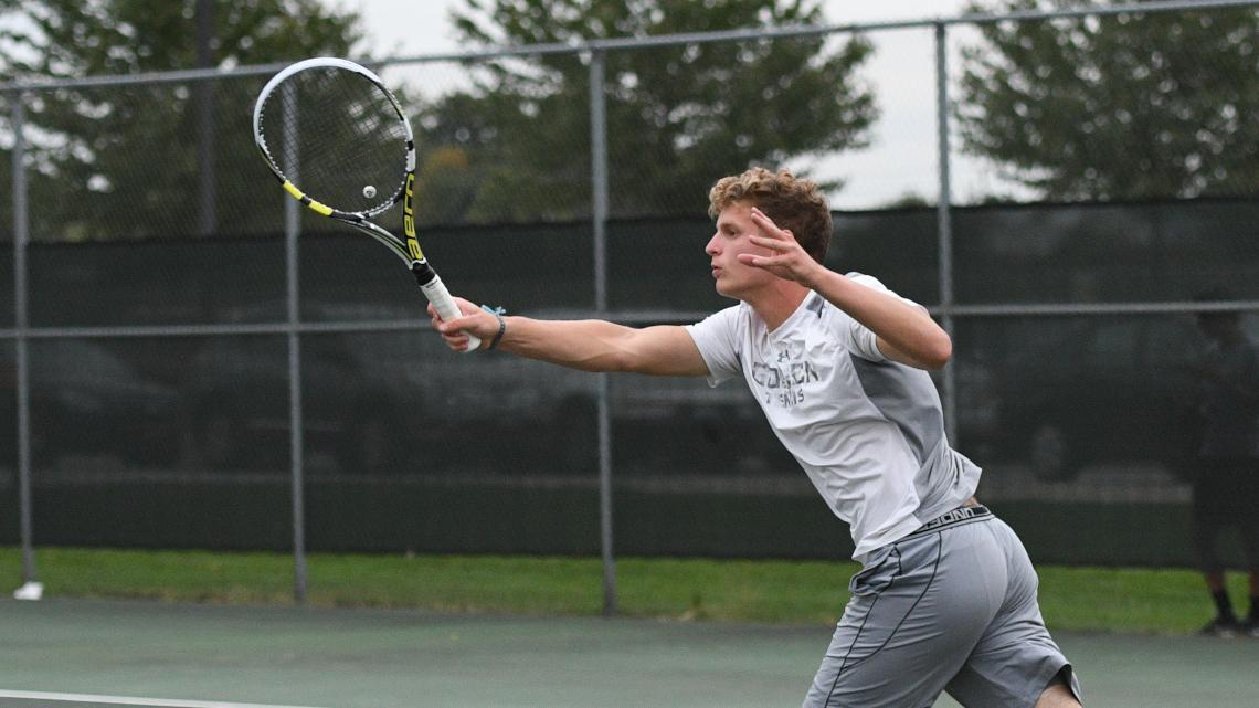 Luke Rush swings his racket during a tennis match