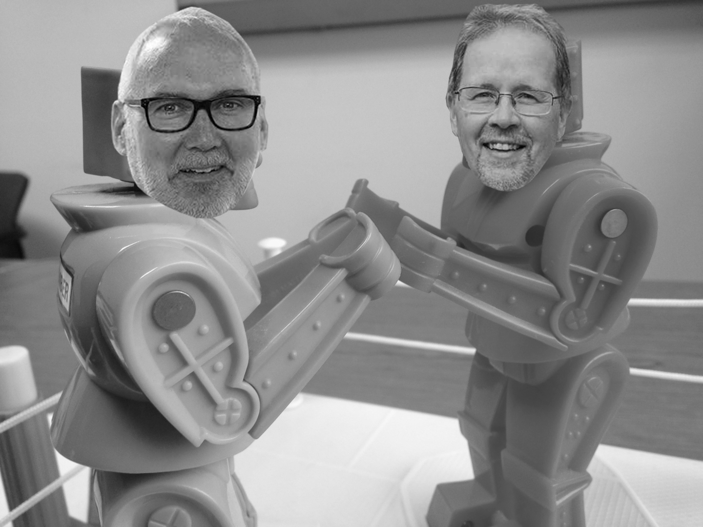 The faces of Keith Graber Miller and John Roth photoshopped onto the bodies of battling robots