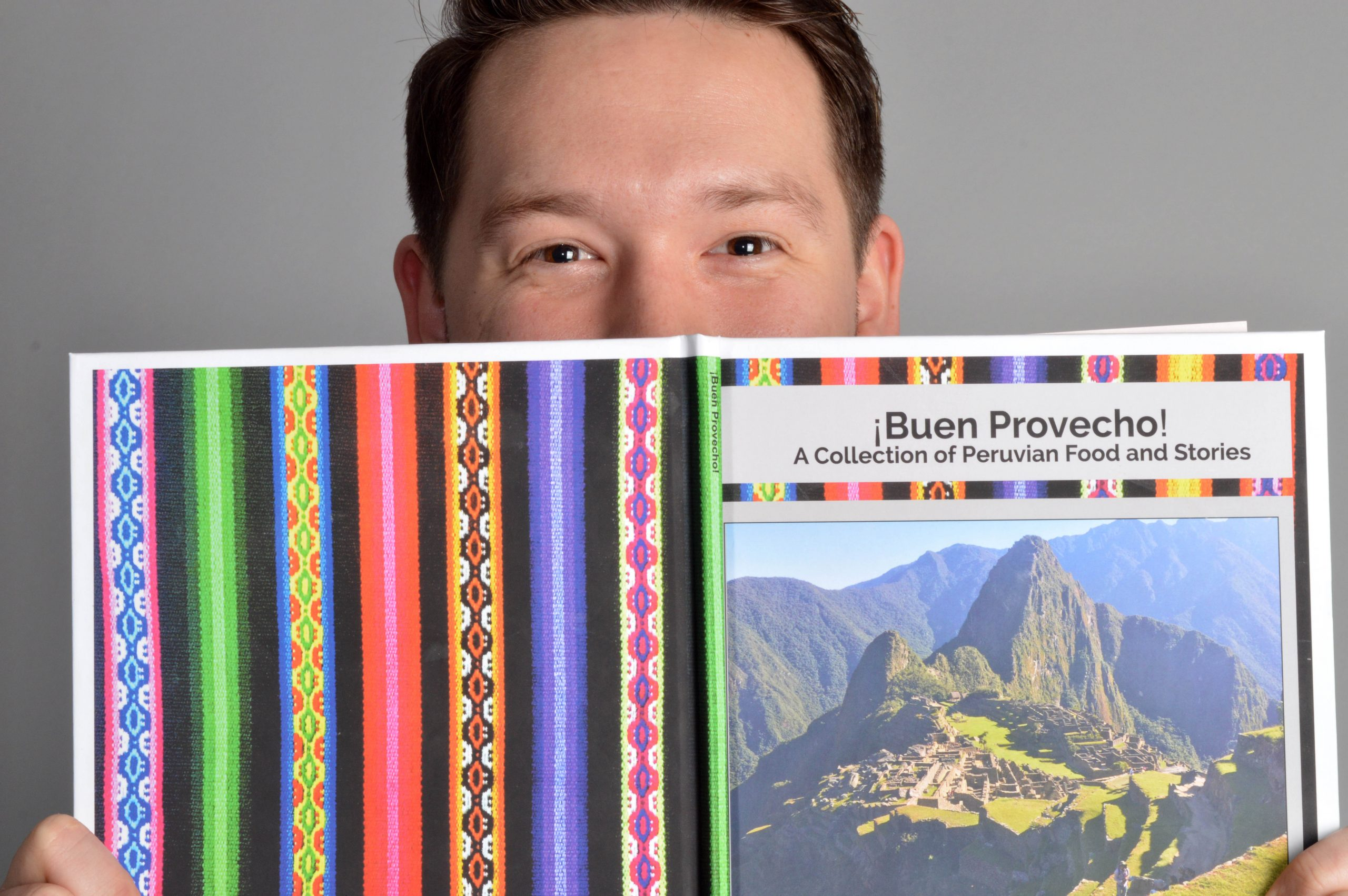 Jonah Yoder with Buen Provecho cookbook
