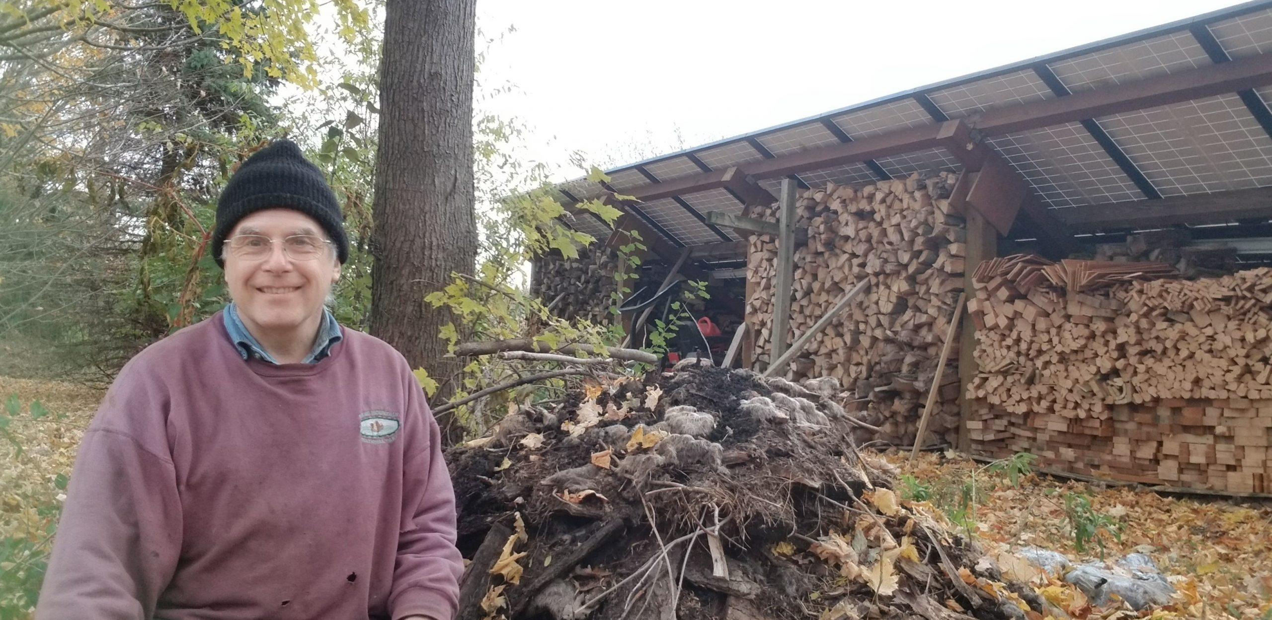 Steve Shantz with his compost pile