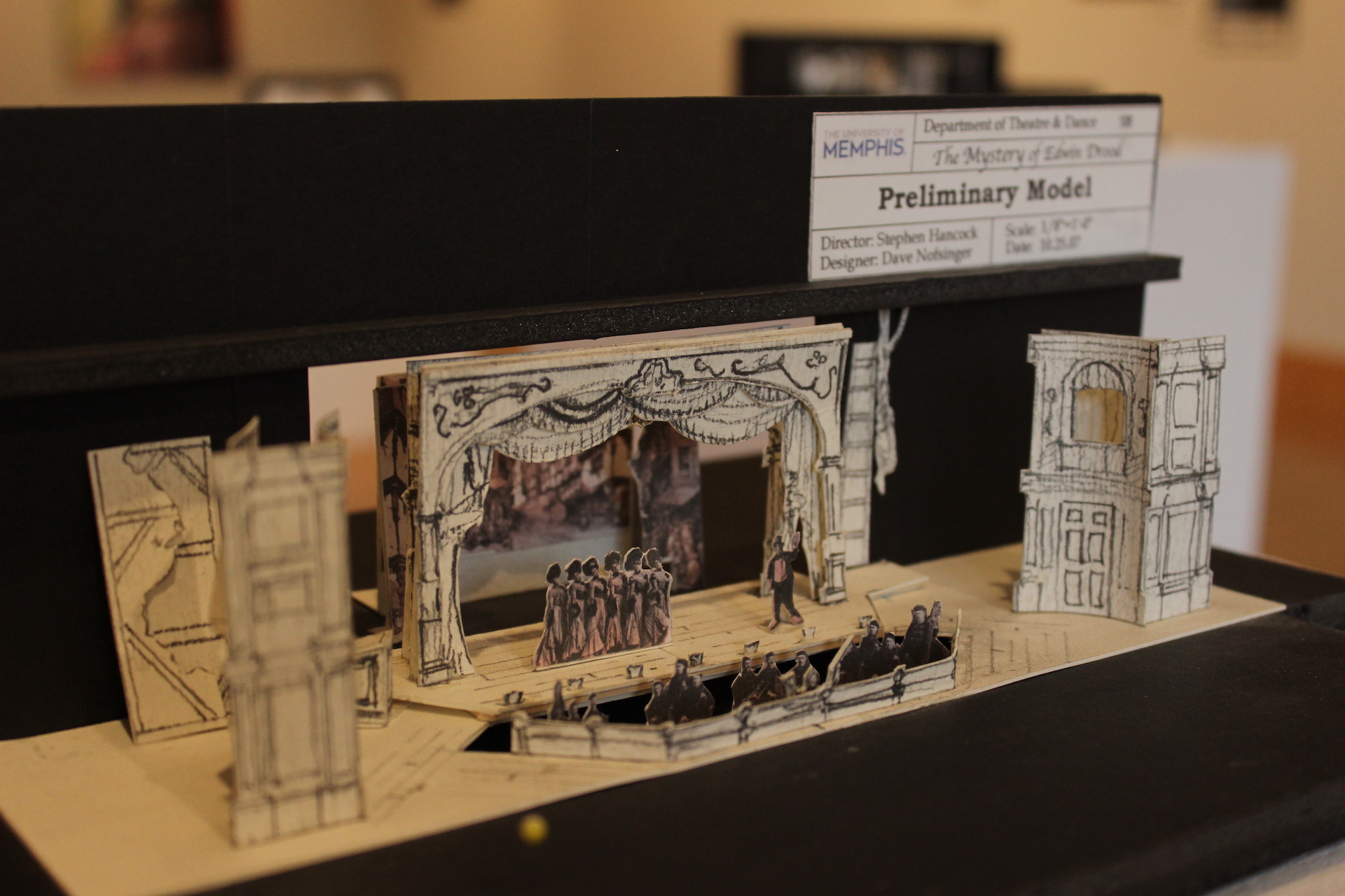A paper model of a stage and theatrical production