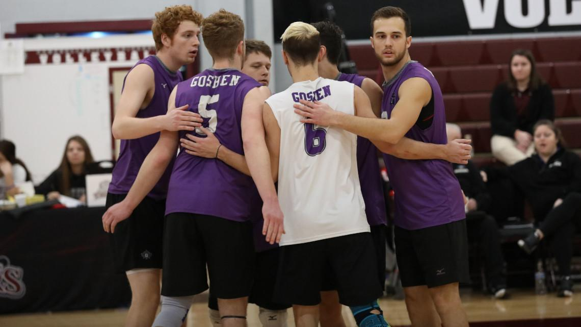 mens volleyball huddles on court