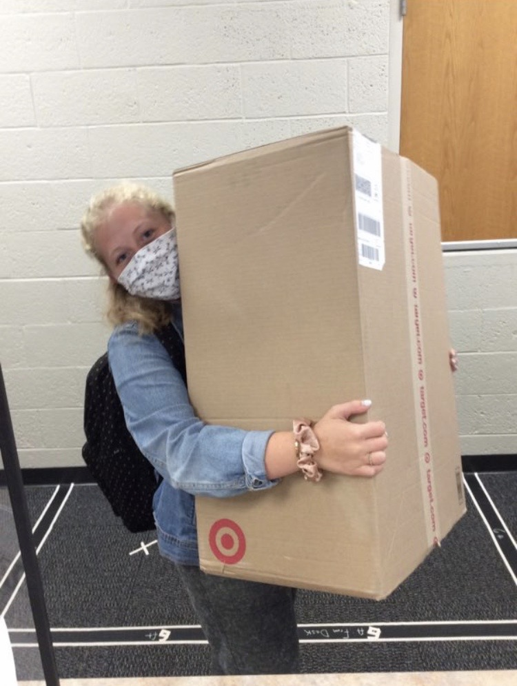 Gretta Rempel holds a package