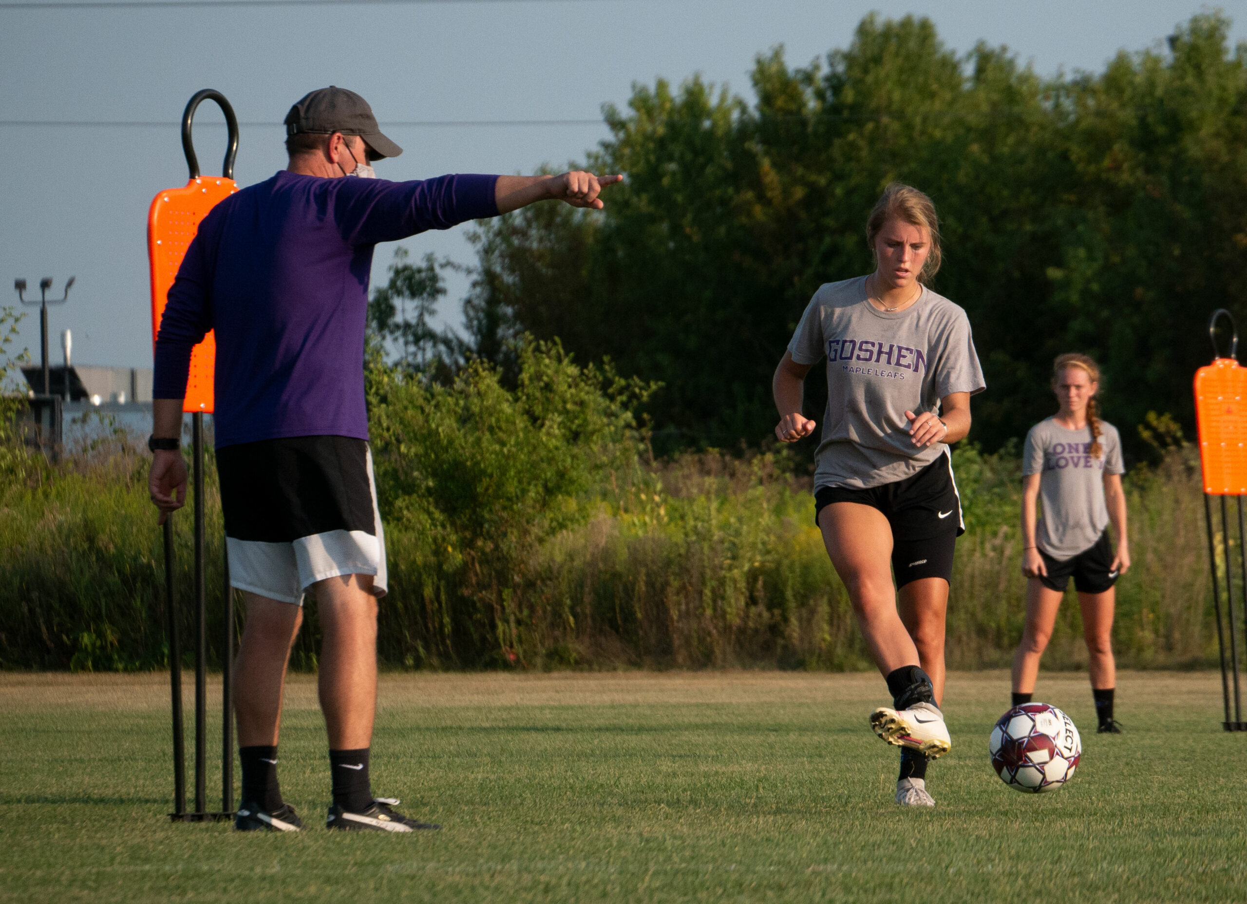 Soccer player and coach in action